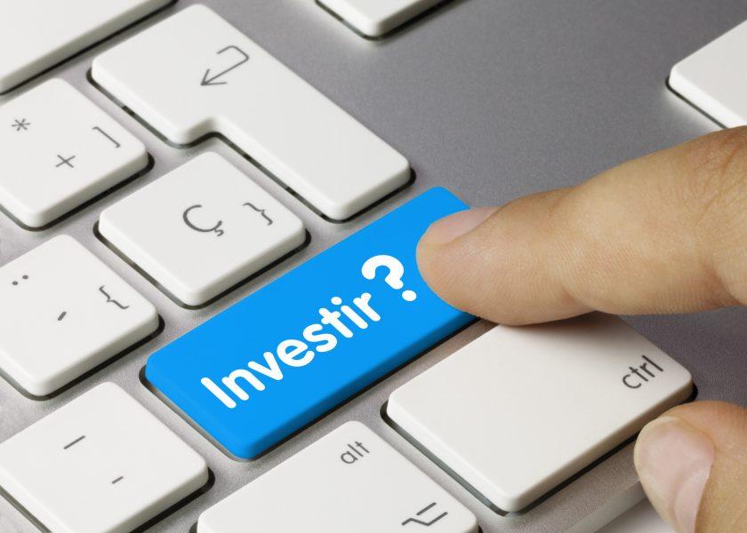 tecla do computador escrito investir?