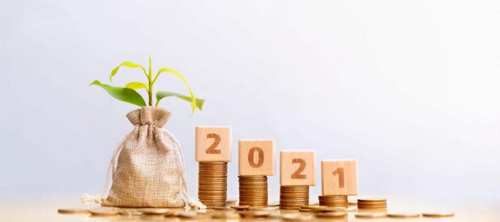 imagem de cubos com 2021 e dinheiro